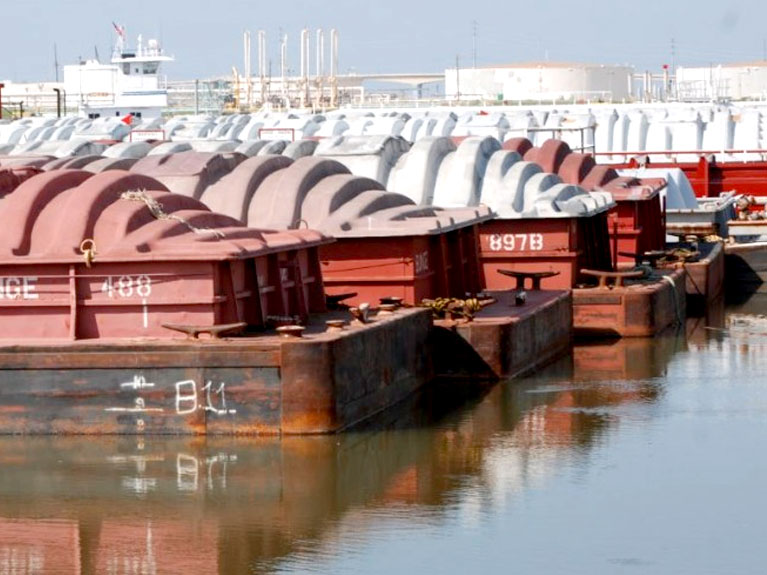 moving cargo by barge at port freeport